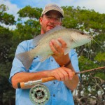 Snow Bound Angler Dreams of Warmer Climes