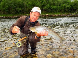 Jeff-Currier-with-Sea-Trout-in-Norway