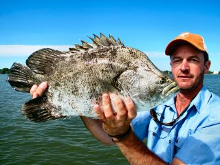 Jeff-Currier-with-a-tripletail-in-Belize